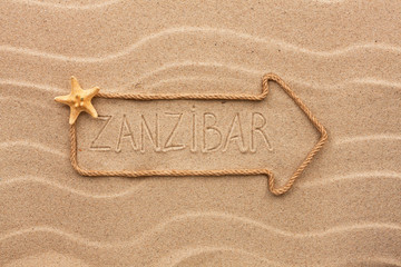 Arrow made of rope and sea shells with the word Zanzibar on the