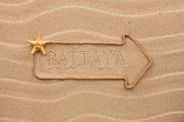 Arrow made of rope and sea shells with the word Pattaya on the s