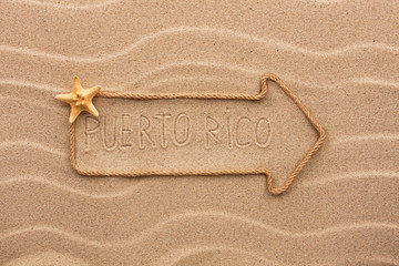 Arrow made of rope and sea shells with the word Puerto Rico on t