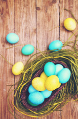 basket of colored eggs, tinted