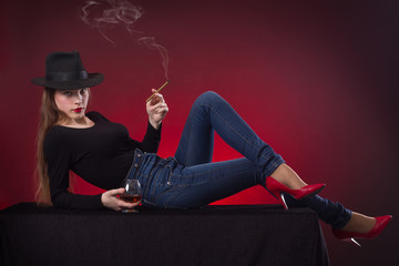 Beautiful sensual young woman with a cigar.