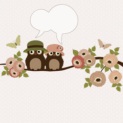 Cute owls on a branch with speech bubble