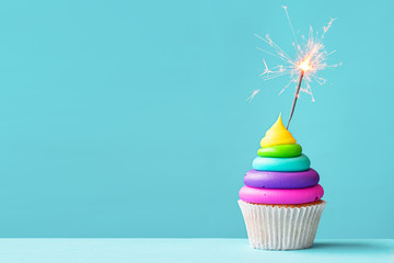 Wall Mural - Colorful cupcake with sparkler