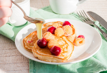 add vanilla pancakes with cherry and raspberry