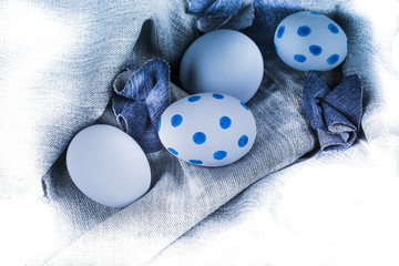 Eggs on a denim material,blue arrangement.