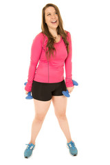 Young woman holding barbells wearing fitness outfit laughing
