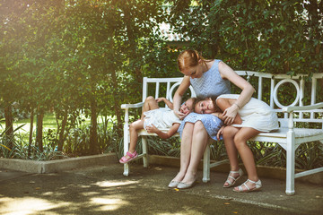 Mother and daughters relax outdoors