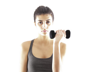 girl exercising with a dumbbell