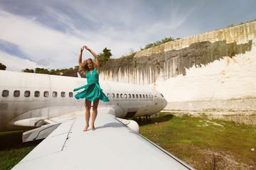 Woman dancing on the wing abandon aircraft