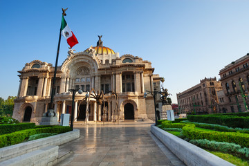 Palace of fine arts facade and Mexican flag