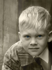 serious young boy monochrome portrait