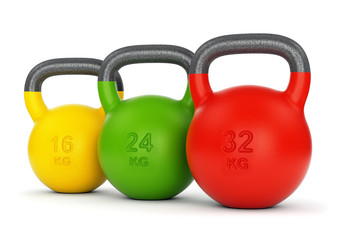 Three colorful kettlebells