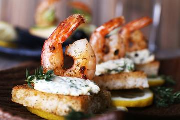Appetizer canape with shrimp and lemon