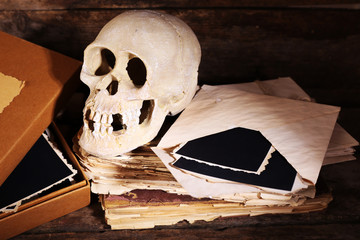Still life with human skull and retro book