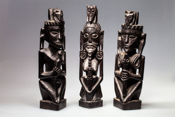 three ethnic wood carved sculptures Borneo