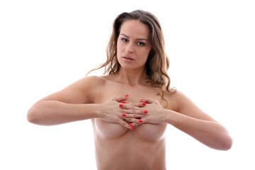 nude beautiful young woman holding her breasts