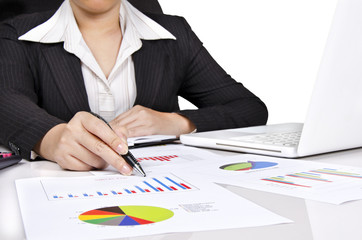 a business woman pointing to a chart