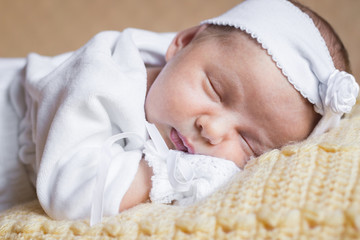 Close-up portrait of newborn baby girl sleeping