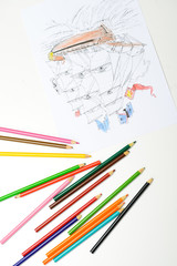 multicolored pencils with pirate boat drawing in white sheet