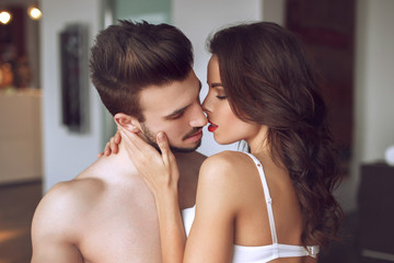 Sexy lovers foreplay at luxury flat