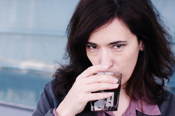 Portrait of beautiful 35 years old woman drinking coffee
