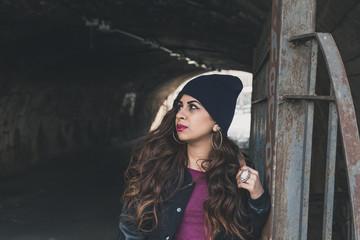 Beautiful girl posing in a tunnel