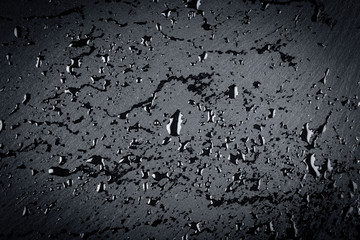 water on dark stone surface