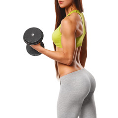 Sexy ass in thong. Sexy athletic woman  with dumbbells