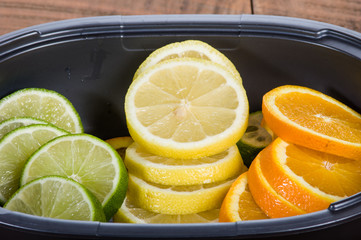 Bowl with lemon, lime and orange