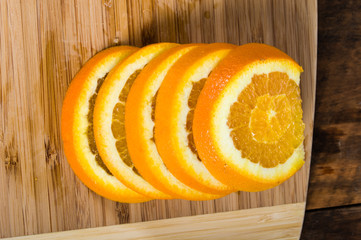 Stack of orange slices on board