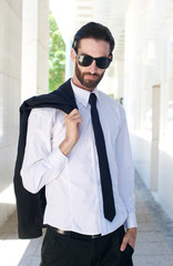 Male fashion model in shirt and tie posing outside