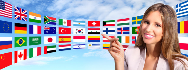 smiling woman shows international flags