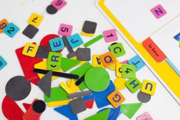 Close up of multi-coloured alphabet puzzle pieces