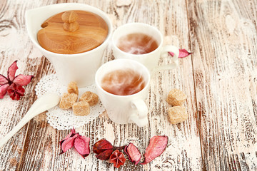 tea with sugar cubes on wooden