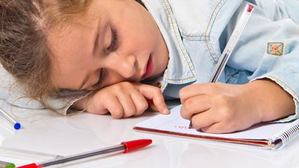 Blonde little girl writing