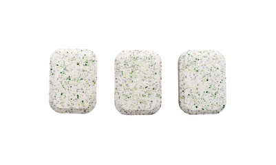 Dishwasher tablets on a white background