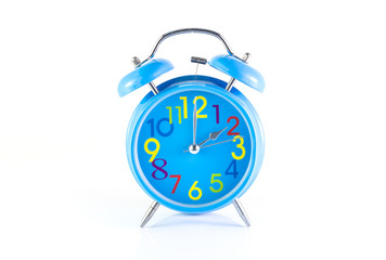 Alarm Clock isolated on white, in blue, showing two o'clock.