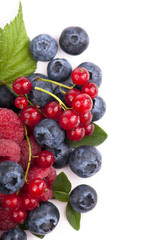 Many blueberries, raspberries. Isolated white