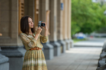 Girl making photo with retro camera