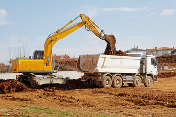 Excavator and tipper truck