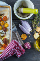 Helthy lunch with roasted baby tomato and herbs