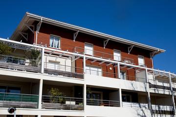 View of a  newly built modern block of flats under blue sky