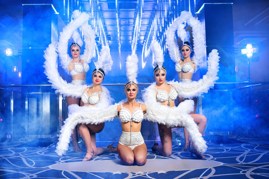 dance group sexy girls in costumes, nightclub