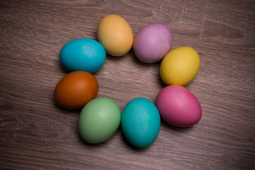 Pastel Easter Eggs Circle Isolated On Wooden background