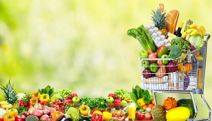 Shopping cart with vegetables and fruits.