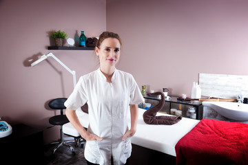 Female beautician in her new modern beauty and massage salon.