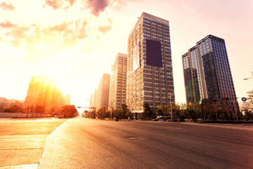 Fotomurales - skyline,urban road and office buildings at sunset