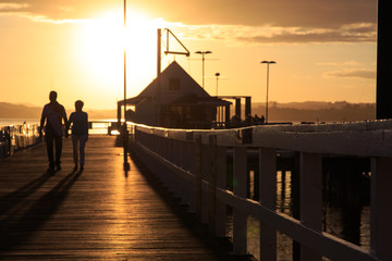Couple at sunset at the pier