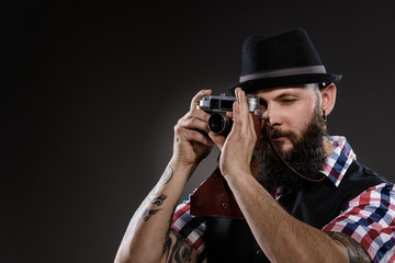 Bearded man in a checkered shirt taking a photo