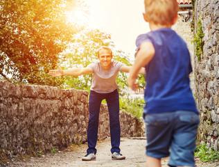 Son runs  to his father hugs